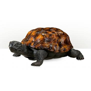 A brass figure of a tortoise