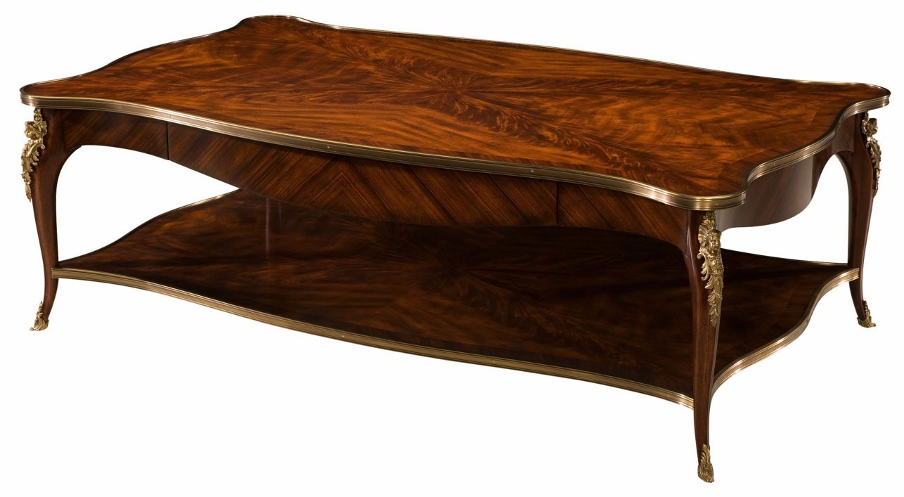 A brass mounted flame mahogany coffee table