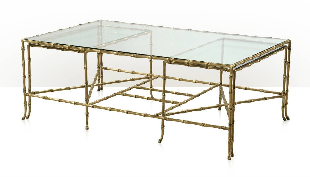 A cast brass and glass cocktail table