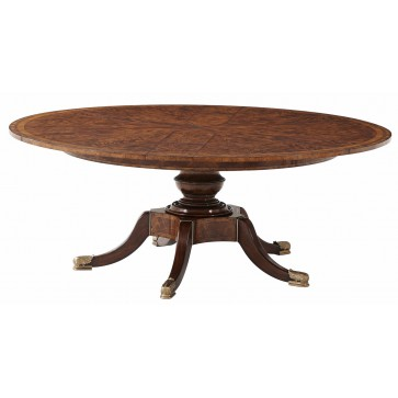 A circular extending mahogany dining table