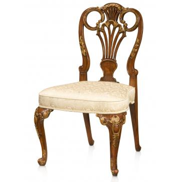 A fine hand carved and gilt side chair