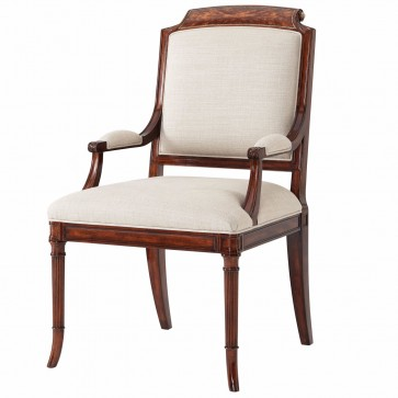 A finely carved mahogany dining armchair