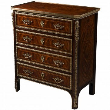 A flame mahogany and ebonised chest of drawers