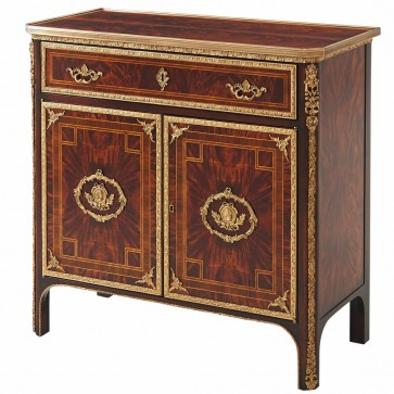 A flame mahogany brass mounted side cabinet