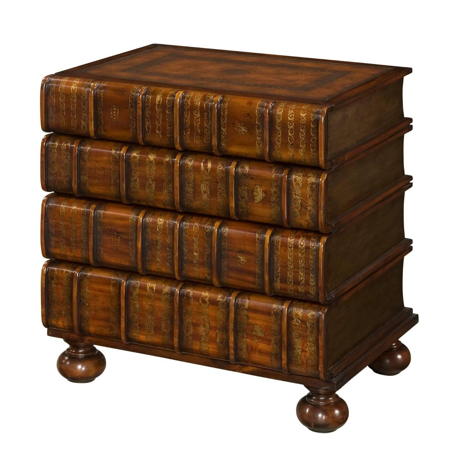 A gilt faux book chest of drawers