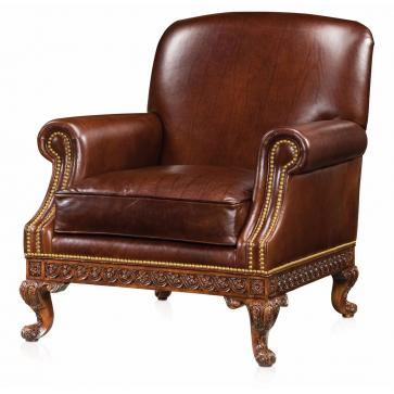 A hand carved club armchair