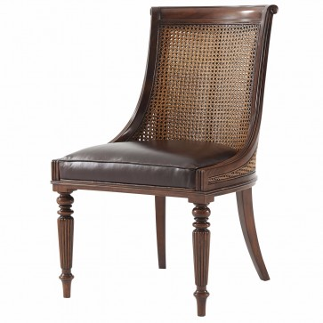 A hand carved mahogany scoop back dining chair