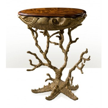 A highly unusual grotto table with coral legs and starfish base