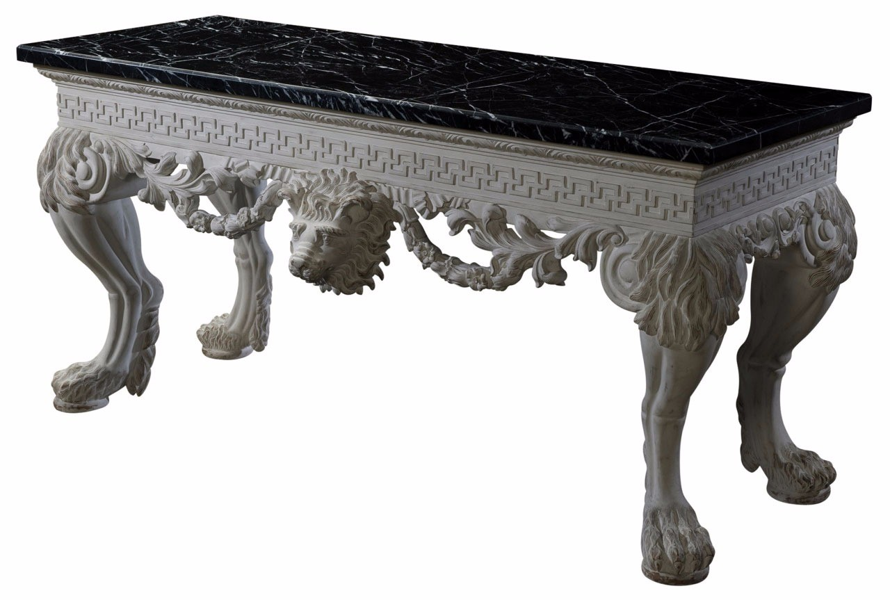 A magnificent and finely carved and white painted console table