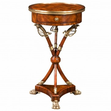 A mahogany lamp table with circular brass bound top