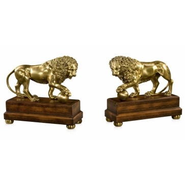 A pair of brass model of Lions