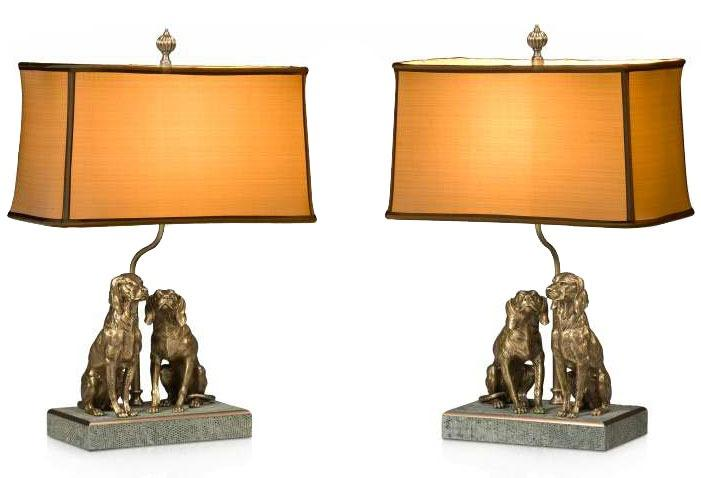 A pair of finely cast brass table lamps