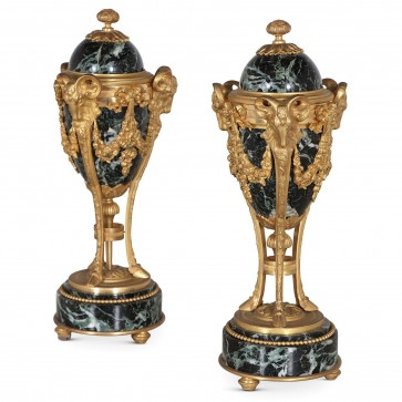 A pair of late 19th century ormolu and marble cassolettes