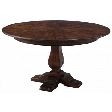 A reclaimed oak circular extending dining table with self storing leaves