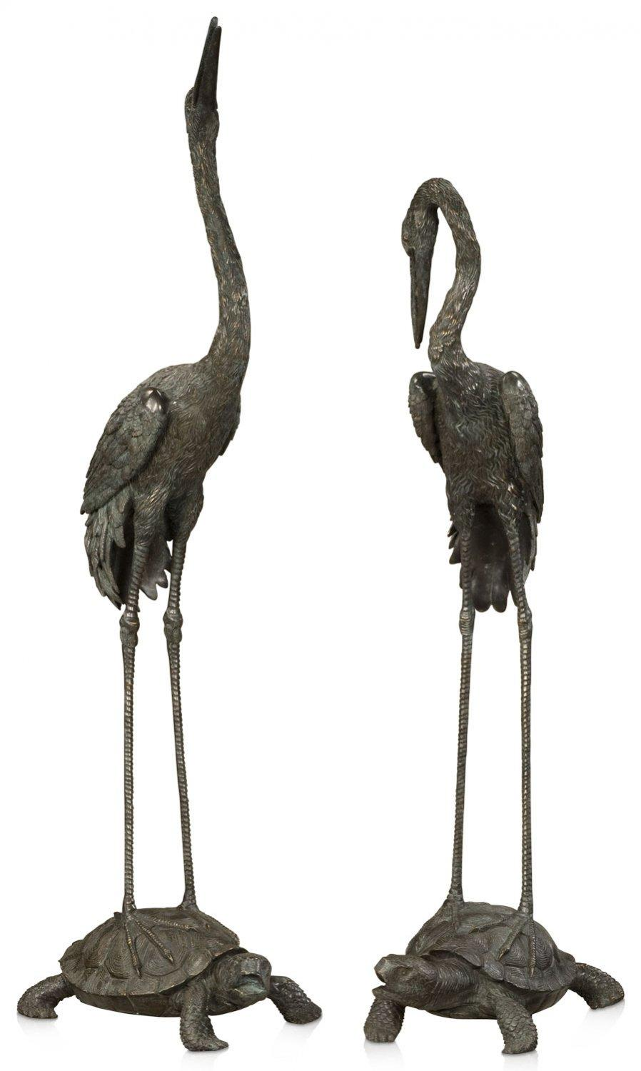 A set of two large verdigris brass cranes
