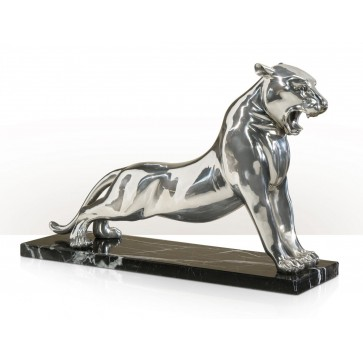 A stainless steel sculpture of a roaring panther