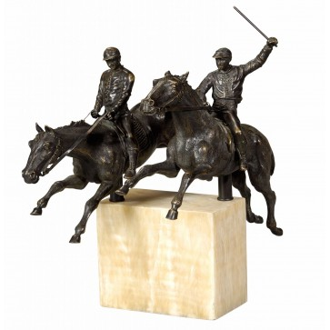 A statue of two race horses and jockeys