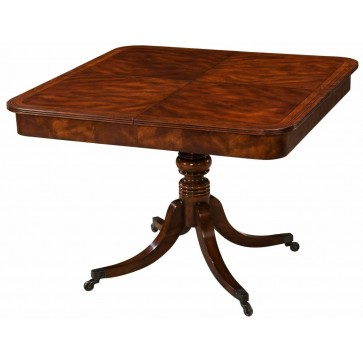 A swirl mahogany veneered extending breakfast table