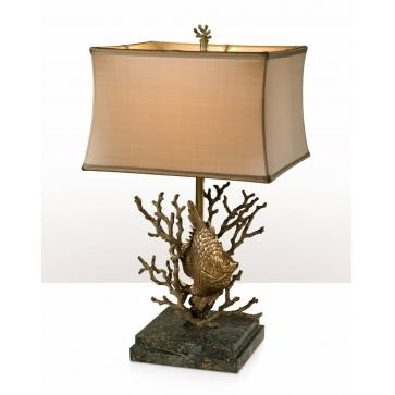 A table lamp with the base of a fish swimming in coral