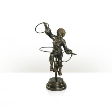 A verdigris brass figure of a clown
