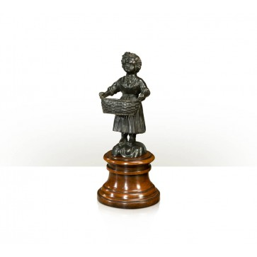 A verdigris brass figure of a young girl