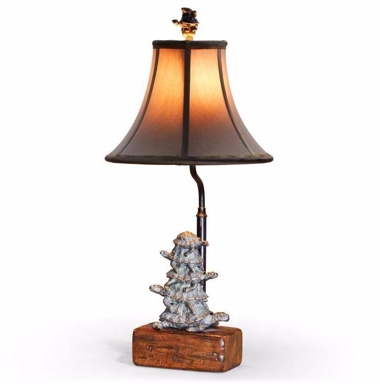 A verdigris brass stacked tortoise table lamp