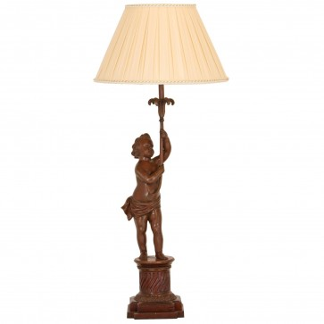 An antiqued brass table lamp with pleated drum shade