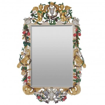 An intricately hand carved mirror with custom finish