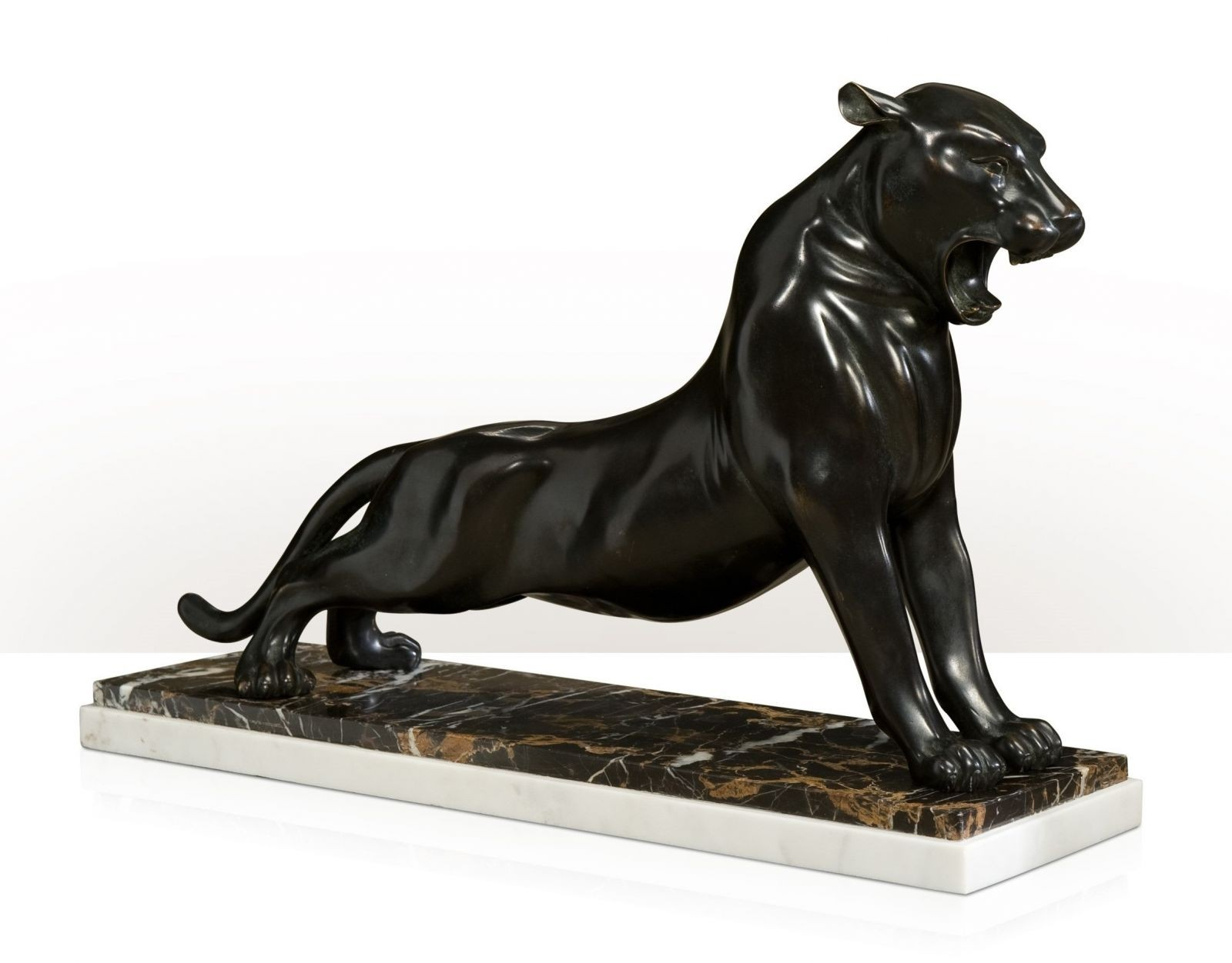 brass sculpture of a roaring panther