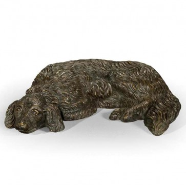 Bronze model of a lying dog