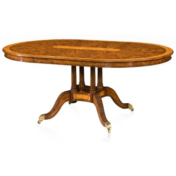 Extending walnut veneered and yew burl banded dining table