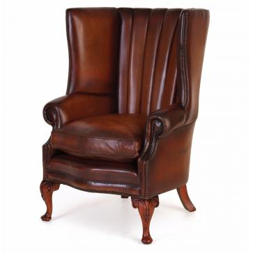 Osbourne wing chair with fluted back in hand dyed hide