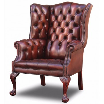 Salisbury wing chair on extended leg in hand dyed hide