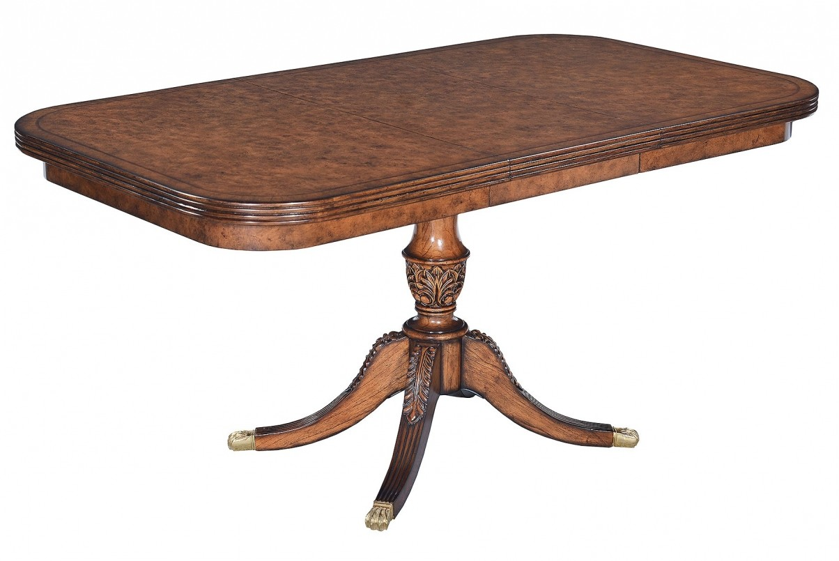 Single pedestal extending dining table in burr oak
