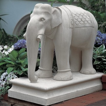 Stone elephant statue on base