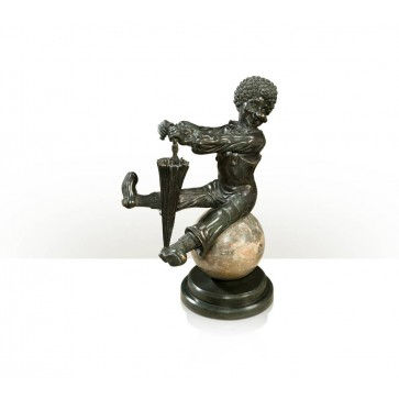 verdigris brass figure of a clown